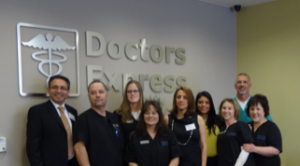 Darius Kerman, Doctors Express owner (far left) and Dr. Mark Siemer (far right) and their staff
